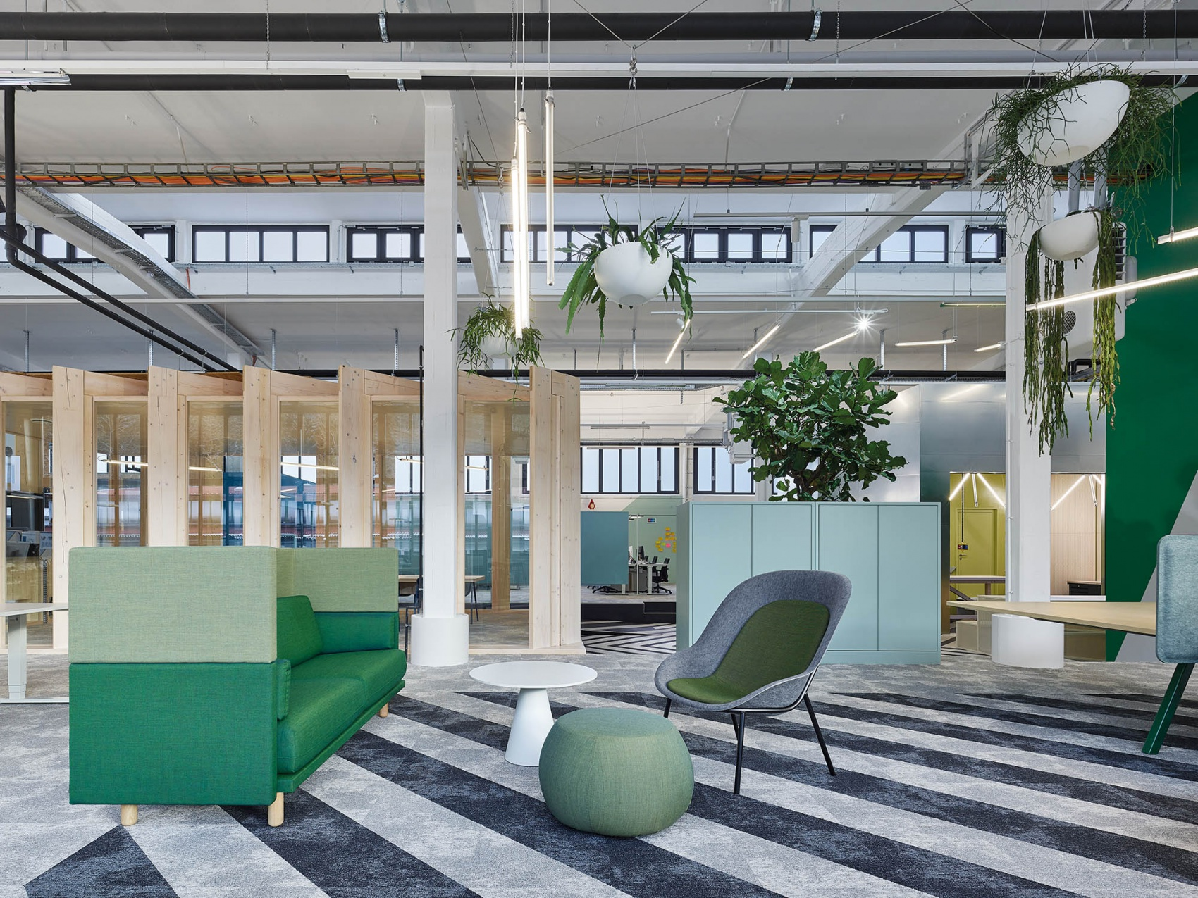 Green design of the lounge zone inside Bosch AS office with Arnhem sofa and Nook lounge chair by  De Vorm