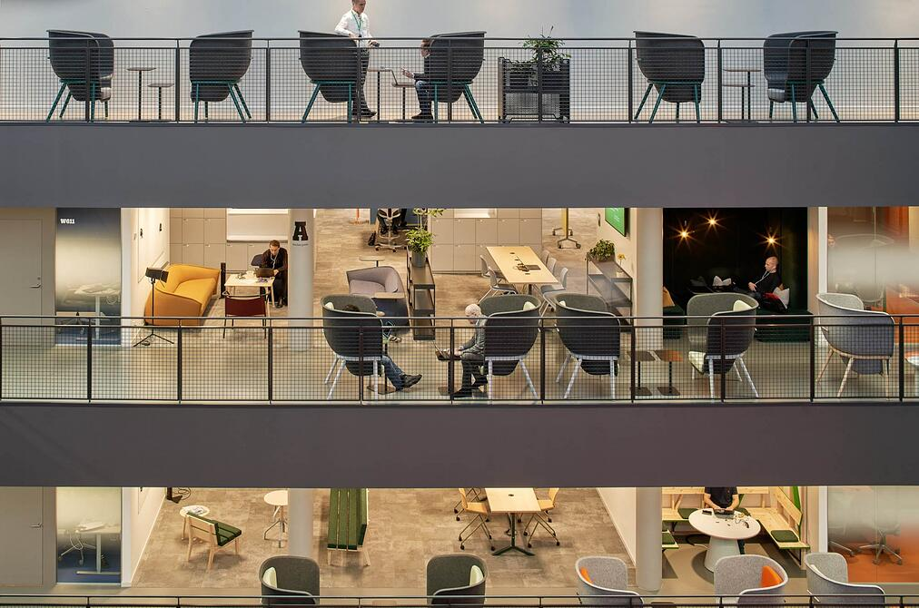 Pod chairs by De Vorm on different floors f Tele 2 office